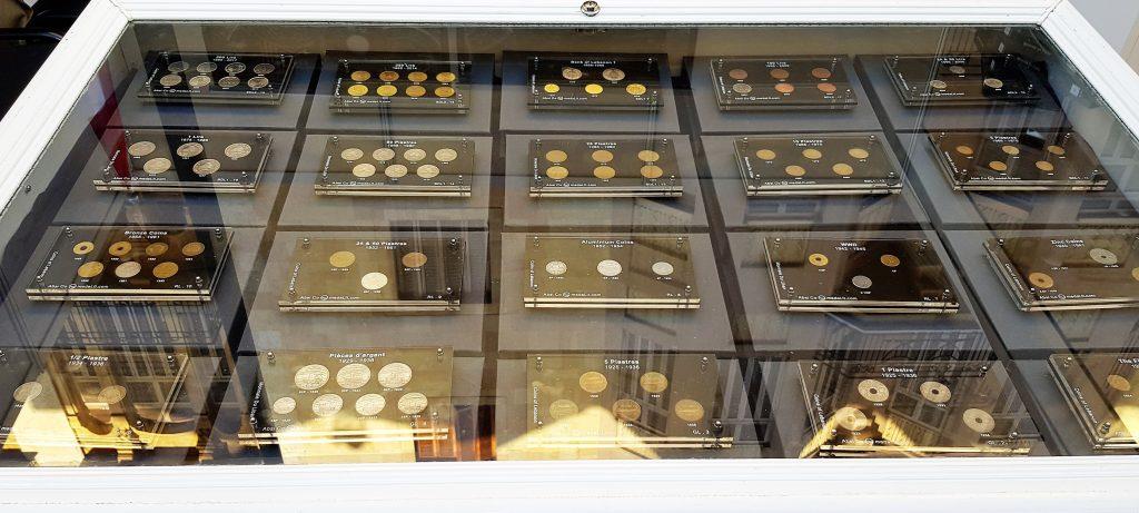 Lebanon coin sets in their airtight frames